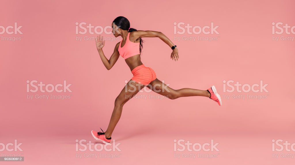 African female runner sprinting royalty-free stock photo