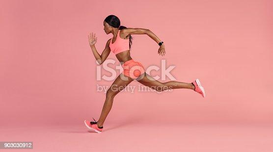 istock African female runner sprinting 903030912