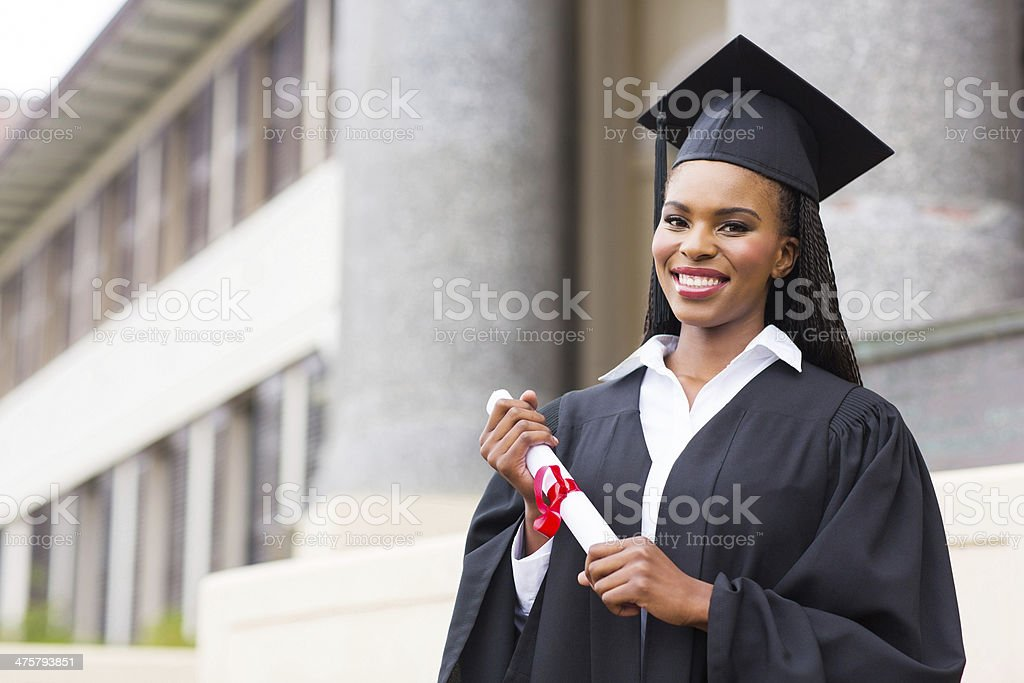 african female student with graduation certificate stock photo
