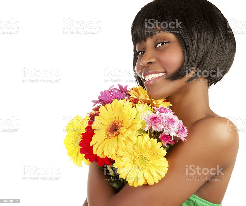 African female with fresh flowers royalty-free stock photo
