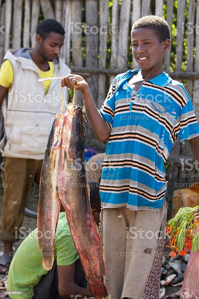 African fisherman and cat fish stock photo
