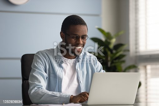1053499704 istock photo African freelancer do remote job typing message on laptop 1252926534