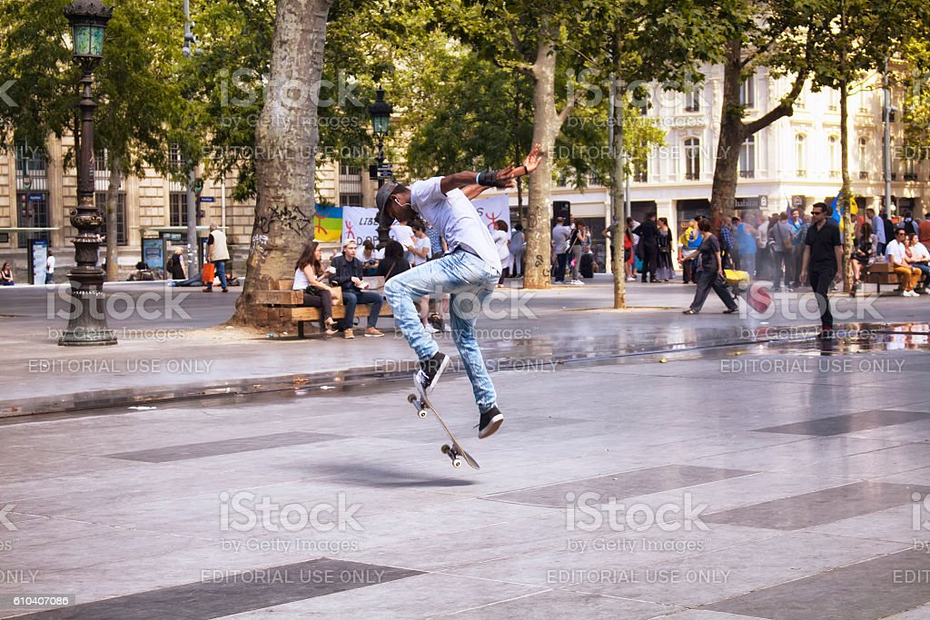 African French young male jumps while skating stock photo