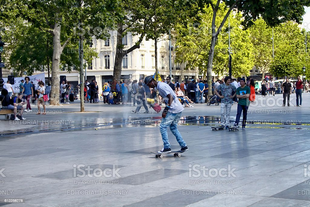 African French young male skates at Republic Square in Paris. stock photo