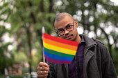 istock African Gay Man Waving Rainbow Flag 1059417114
