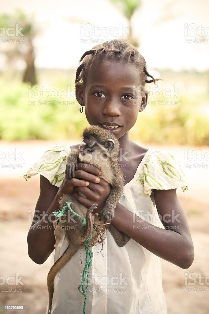 African Girl and Monkey royalty-free stock photo