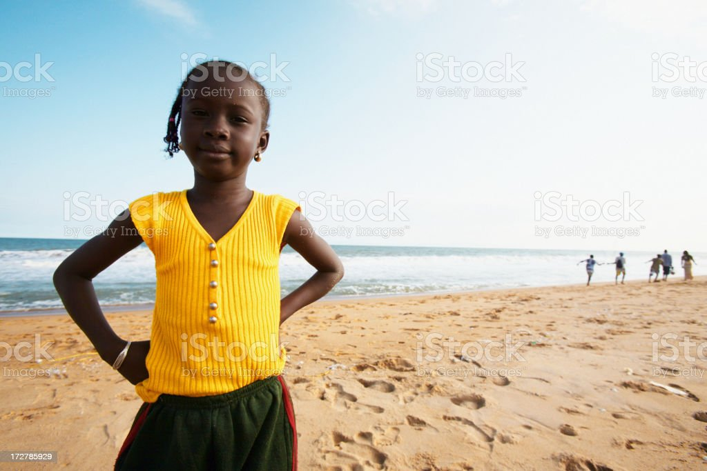 african girl at beach stock photo