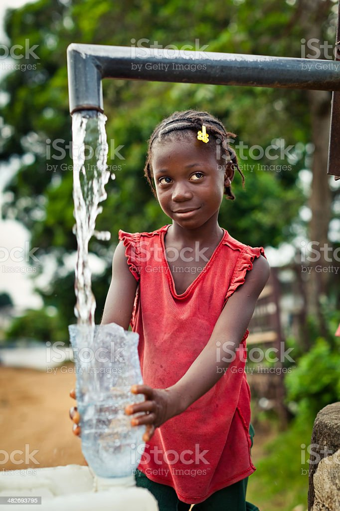 African Girl By Water Pump royalty-free stock photo