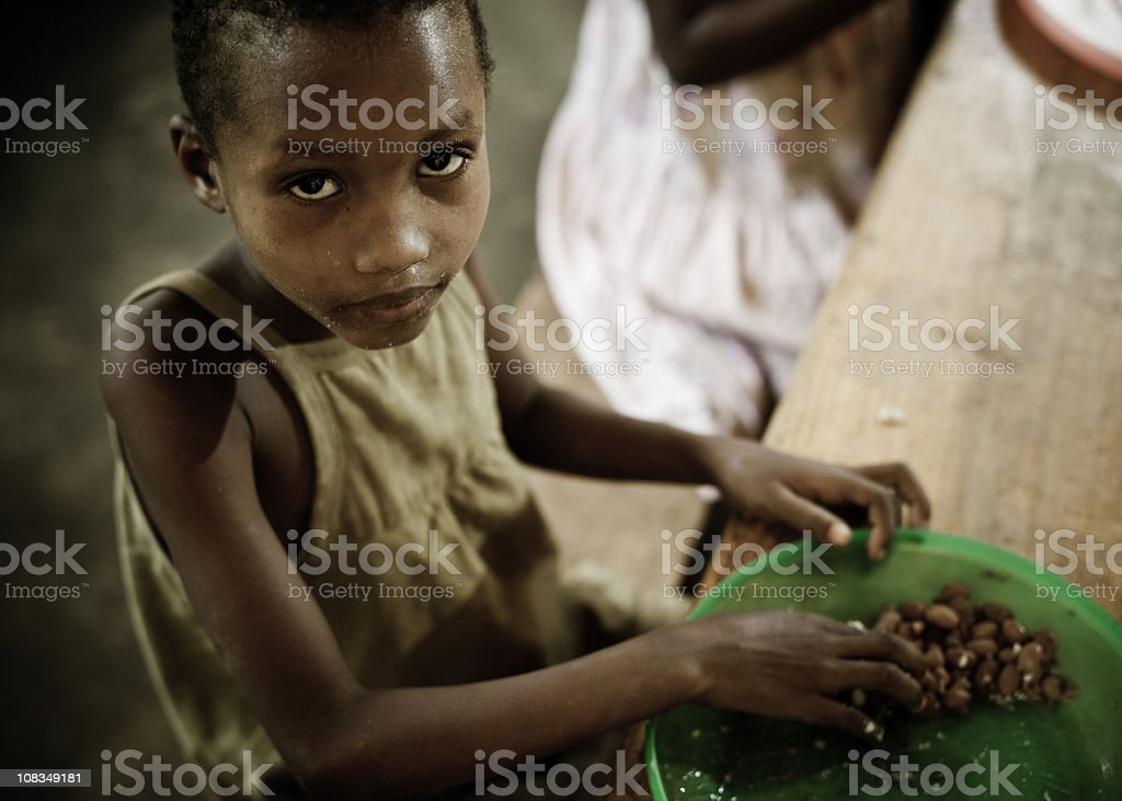 African Girl Eating a Meal in the Orphanage stock photo