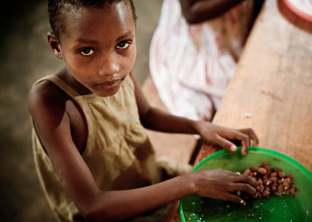 african girl eating a meal in the orphanage - hungrig bildbanksfoton och bilder
