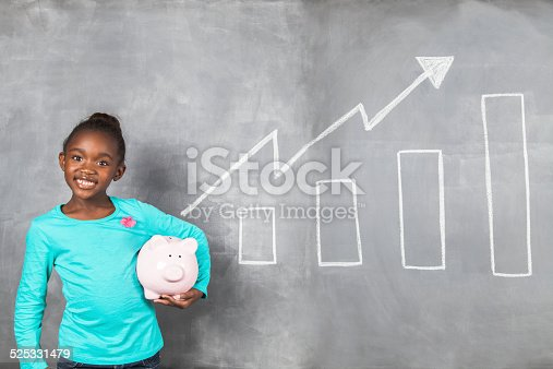 istock African girl happy with the growth of her savings 525331479