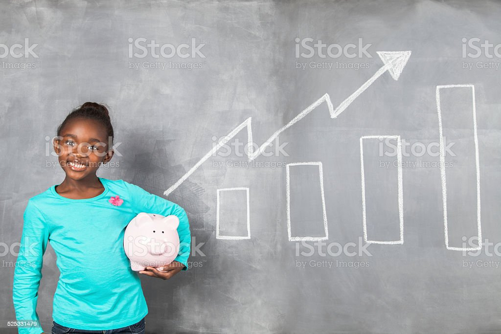 African girl happy with the growth of her savings stock photo