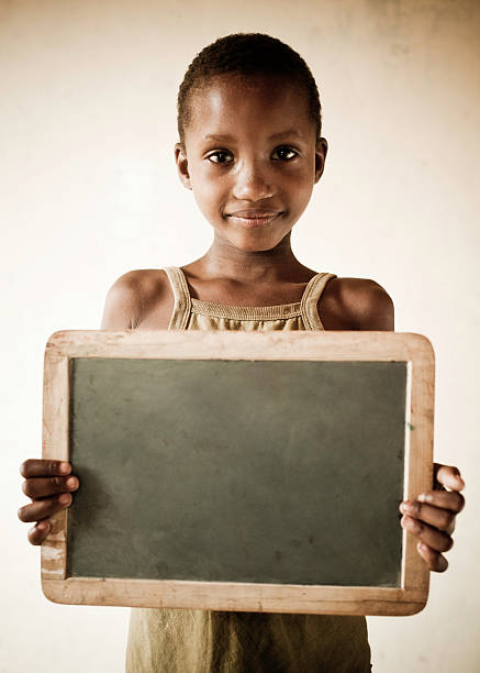 African Girl Holding a Blank Chalkboard stock photo