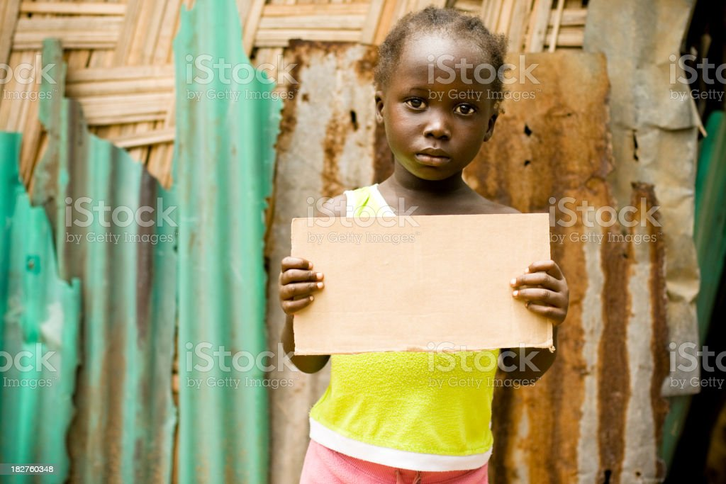 African girl holding a blank sign stock photo