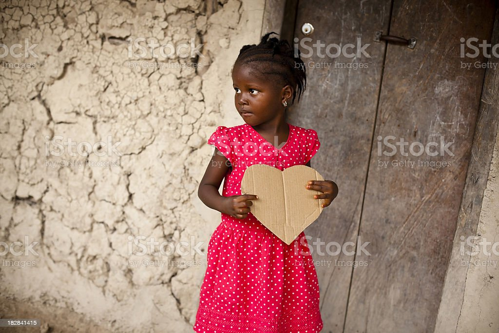 African Girl Holding Heart Shaped Sign stock photo