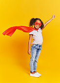 African girl in superhero costume