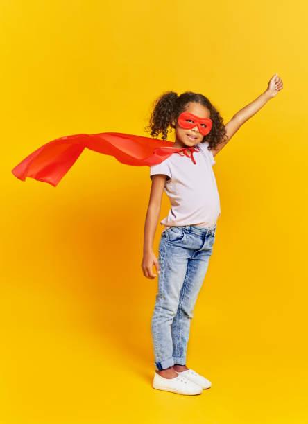 African girl in superhero costume stock photo