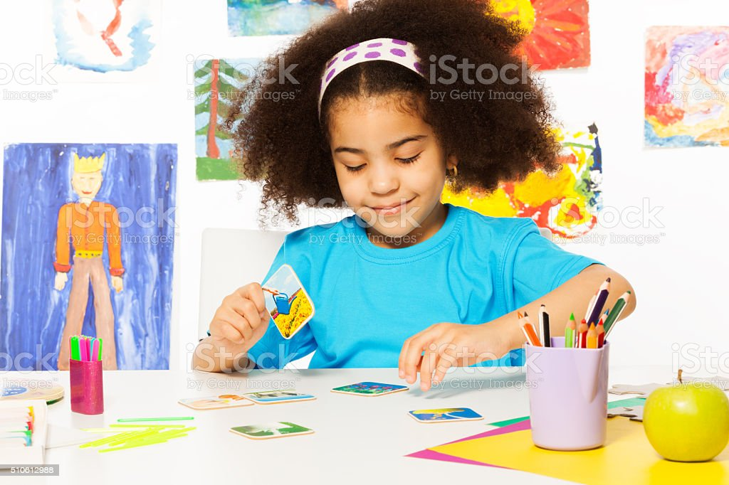 African girl match cards during developmental game stock photo