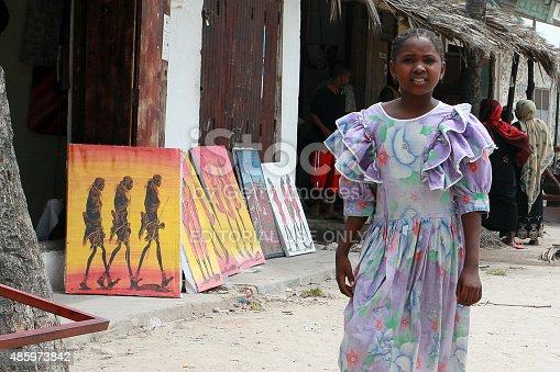 istock African girl misses souvenir shop and art outdoor. 485973842
