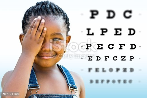 istock African girl testing vision. 507121148
