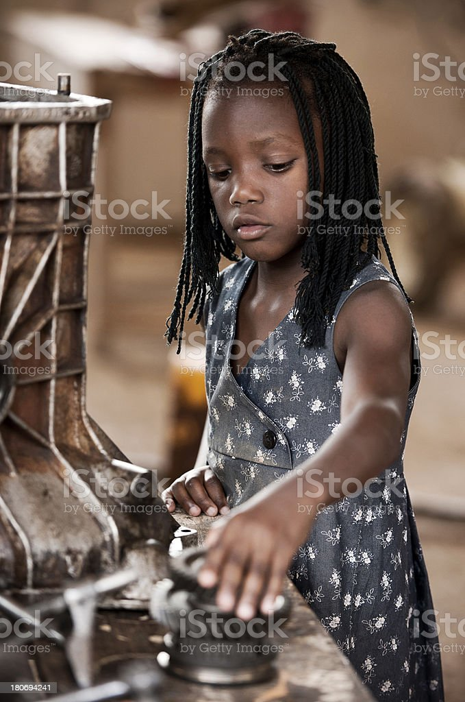 African girl with spare parts royalty-free stock photo