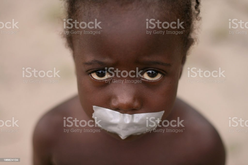 African Girl with Tape on Mouth stock photo