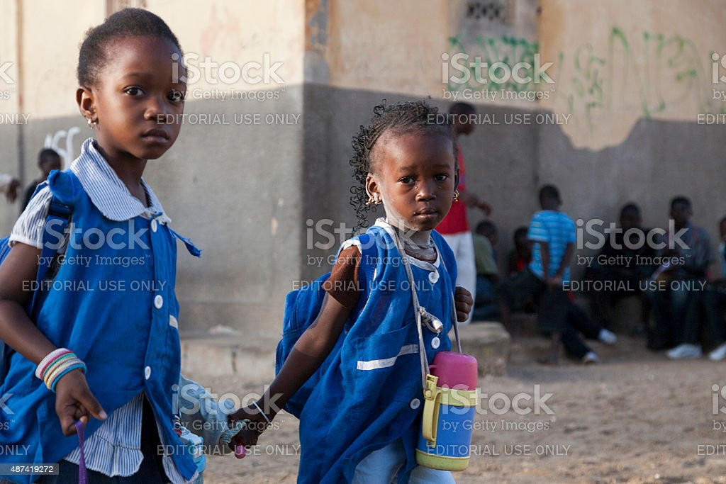 African girls dressed in blue on the way to school stock photo