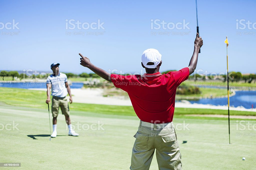 African golfer celebrating his great putt stock photo