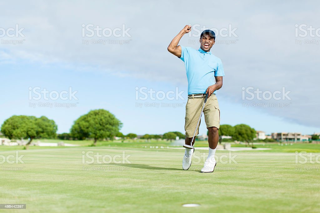 African golfer celebrating his win! stock photo