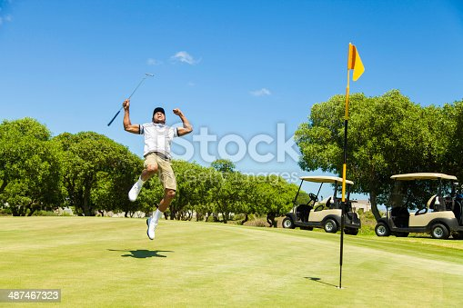 925466128istockphoto African golfer celebrating sinking his putt! 487467323