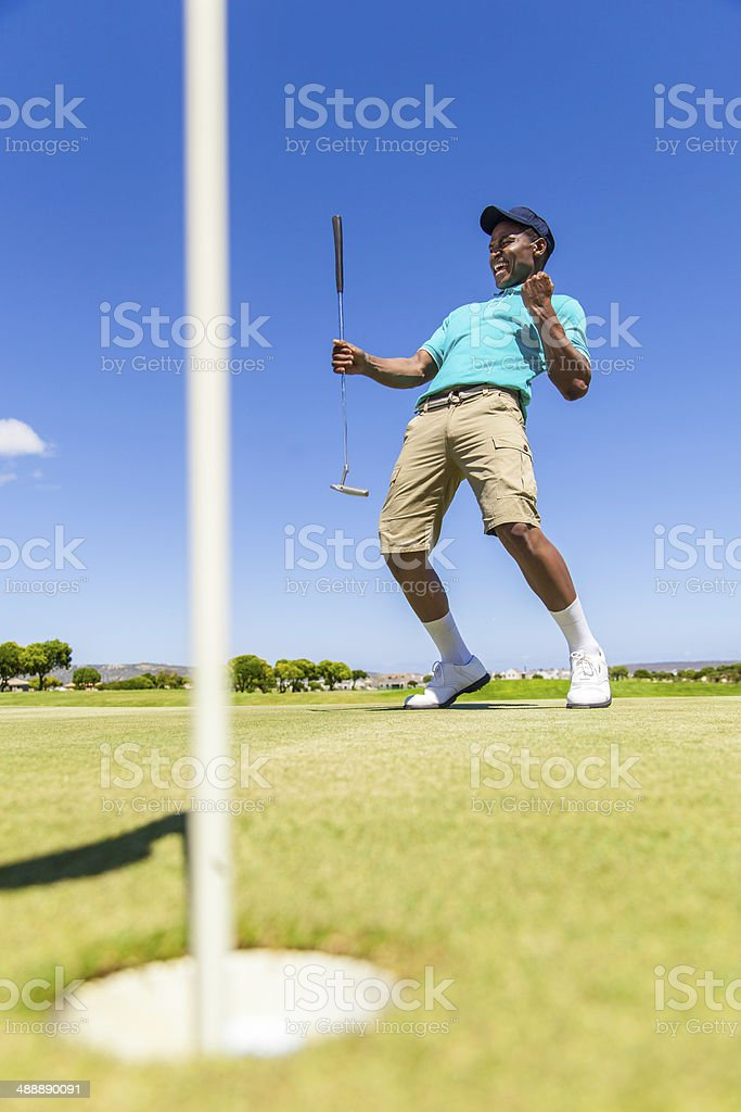 African golfer celebrating sinking his putt! royalty-free stock photo