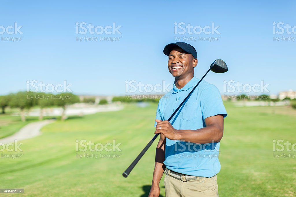 African golfer having a good laugh stock photo