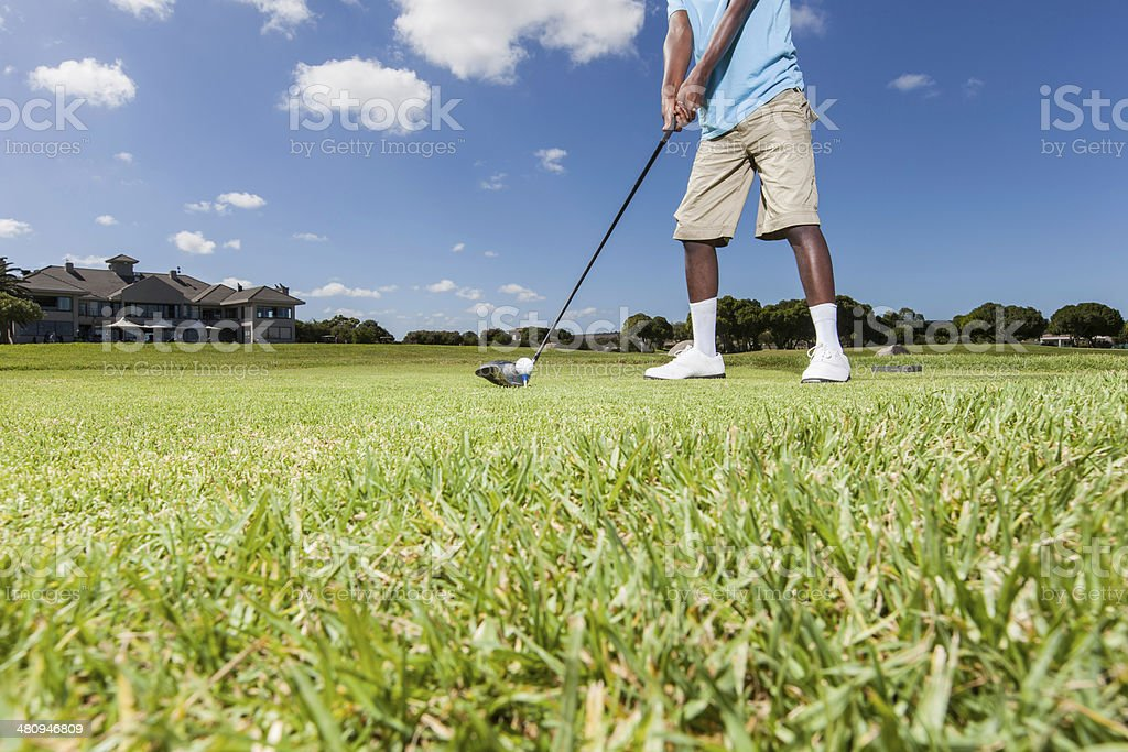 African golfer ready to hit the golf ball royalty-free stock photo