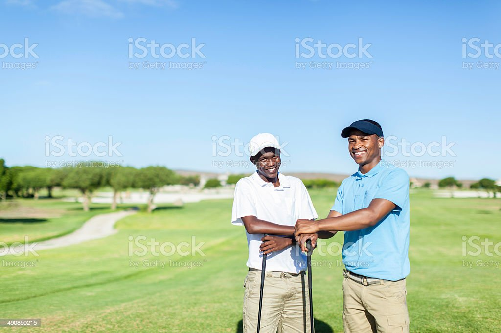 African golfers having a conversation about their golf clubs stock photo