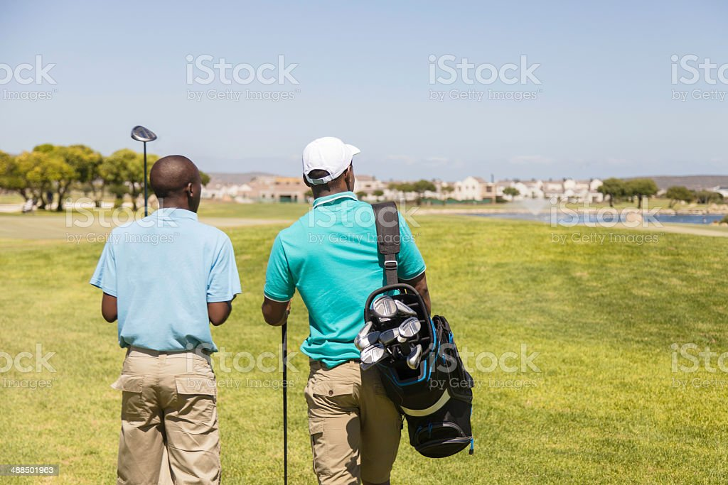 African golfers surveying the golf course stock photo