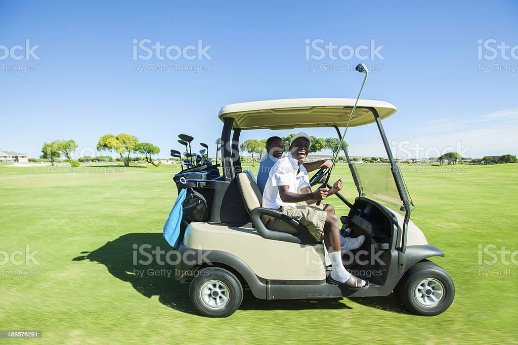 African golfers transporting to their next location. royalty-free stock photo