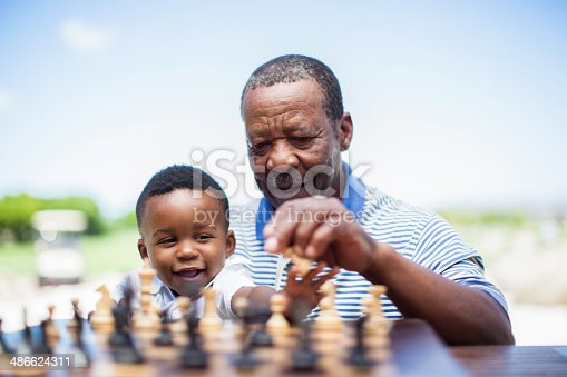 istock African grandfather playing chess with his grandson 486624311