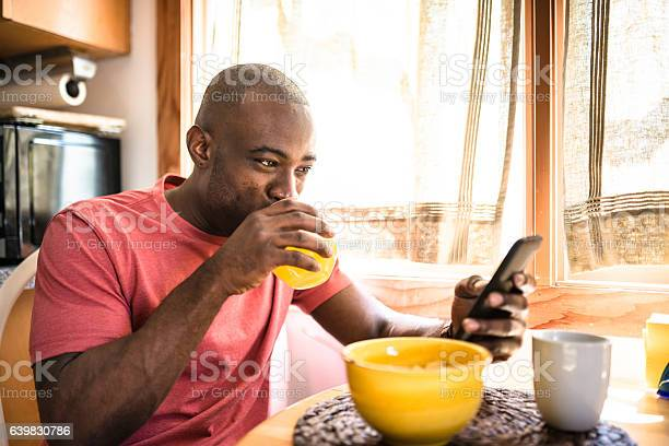 African guy doing breakfast at home picture id639830786?b=1&k=6&m=639830786&s=612x612&h=koql65awlteni1ignjoo4nfwuszoa1lb5rakhmmyxoc=
