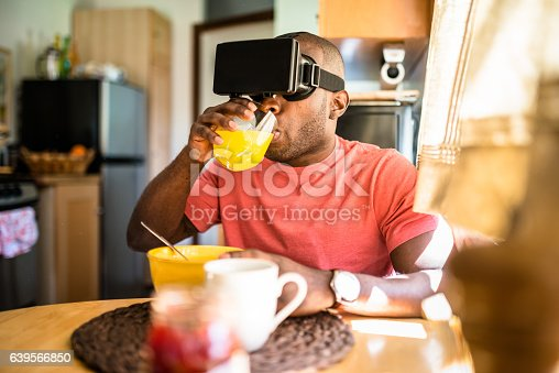 istock african guy entartains his self with virtual reality device simulator 639566850
