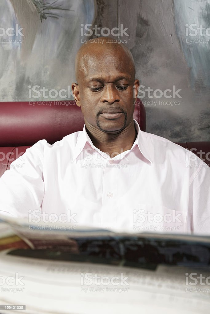 African guy reading paper royalty-free stock photo