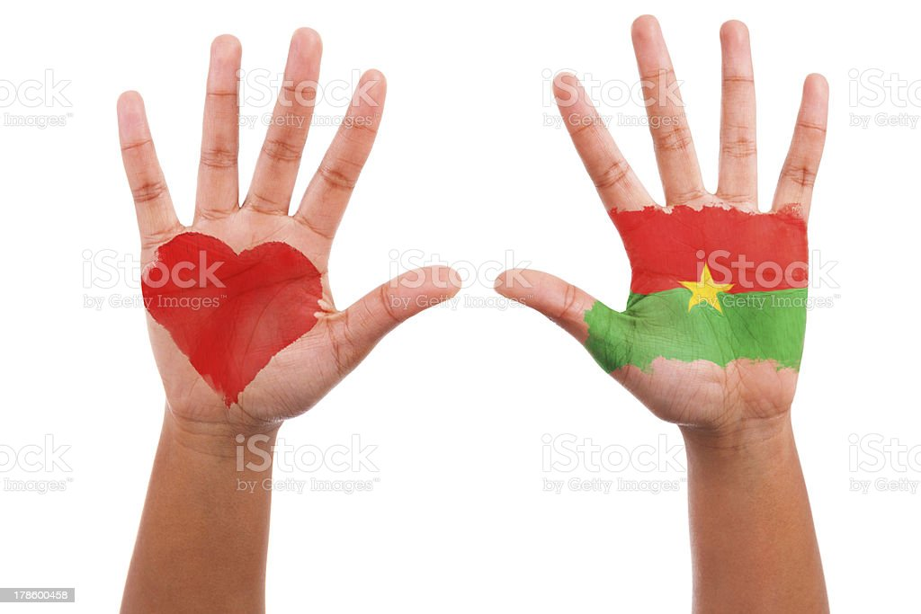 African hands with a painted heart and burkinabe flag royalty-free stock photo