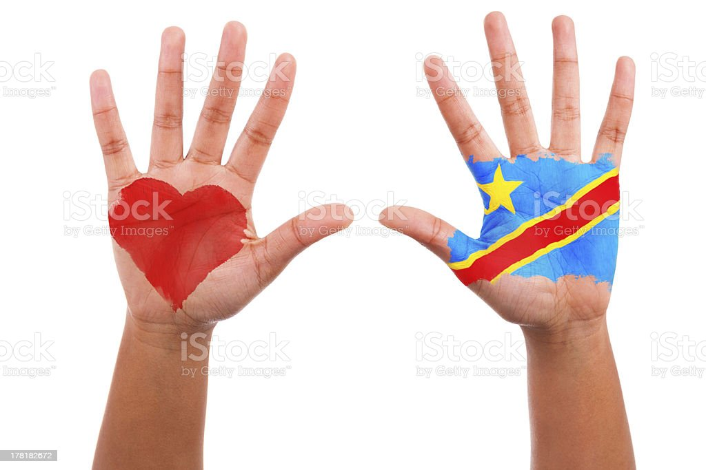 African hands with a painted heart and consolese flag royalty-free stock photo