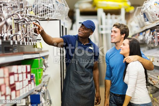 536952169 istock photo african hardware store assistant helping customers 525434045
