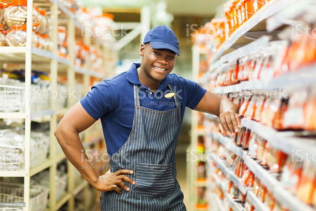 african hardware store worker stock photo
