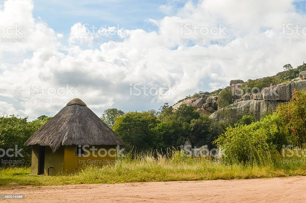 African hut against a rocky background stock photo