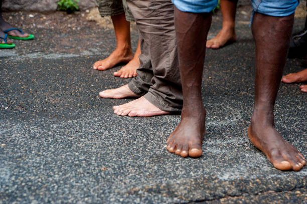 african immigrants bare feet at march asking for hospitality for refugees in rome - welcome march stock photos and pictures