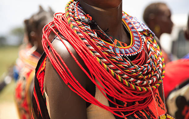 African jewellery on a female, Samburu tribe Kenya Africa African jewellery on a woman from the Samburu tribe Kenya Africa (350dpi) masai mara national reserve stock pictures, royalty-free photos & images