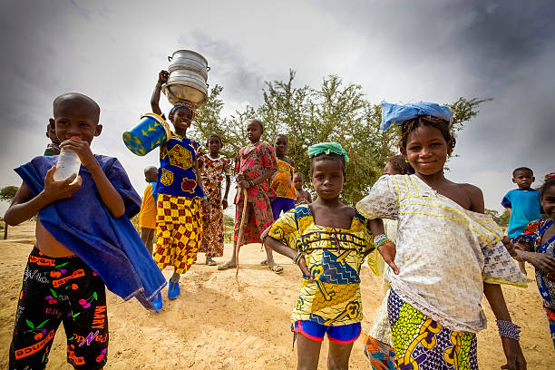 African kids walking in the countryside, Mali stock photo
