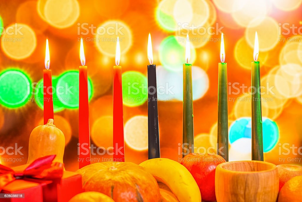 african Kwanzaa festive concept with decorate seven candles red, - Photo