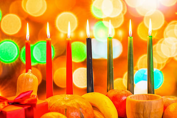 african Kwanzaa festive concept with decorate seven candles red, - foto de stock